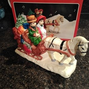 Brinn's musical Christmas sleigh figurine